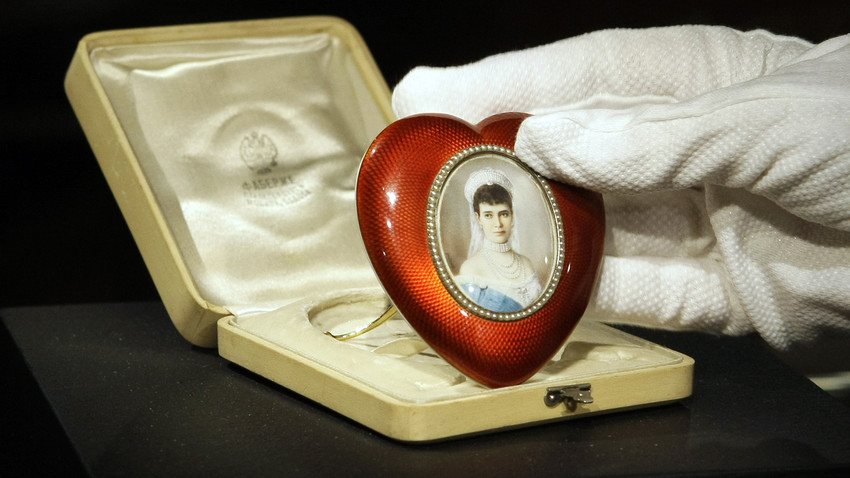 A Faberge silver-gilt, pearl and enamel heart-shaped photograph frame enclosing a miniature of Empress Maria Fedorovna