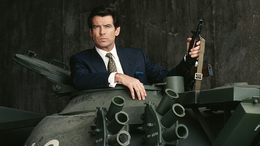 Irish actor Pierce Brosnan poses in the hatch of a Russian T55 Main Battle Tank holding a Kalashnikov automatic rifle, in a publicity still for the James Bond film 'GoldenEye', 1995