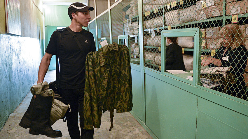 A reservist summoned for training, at the personnel reception facility of a base for storing, repairing and reconstructing military equipment in the city of Novosibirsk.