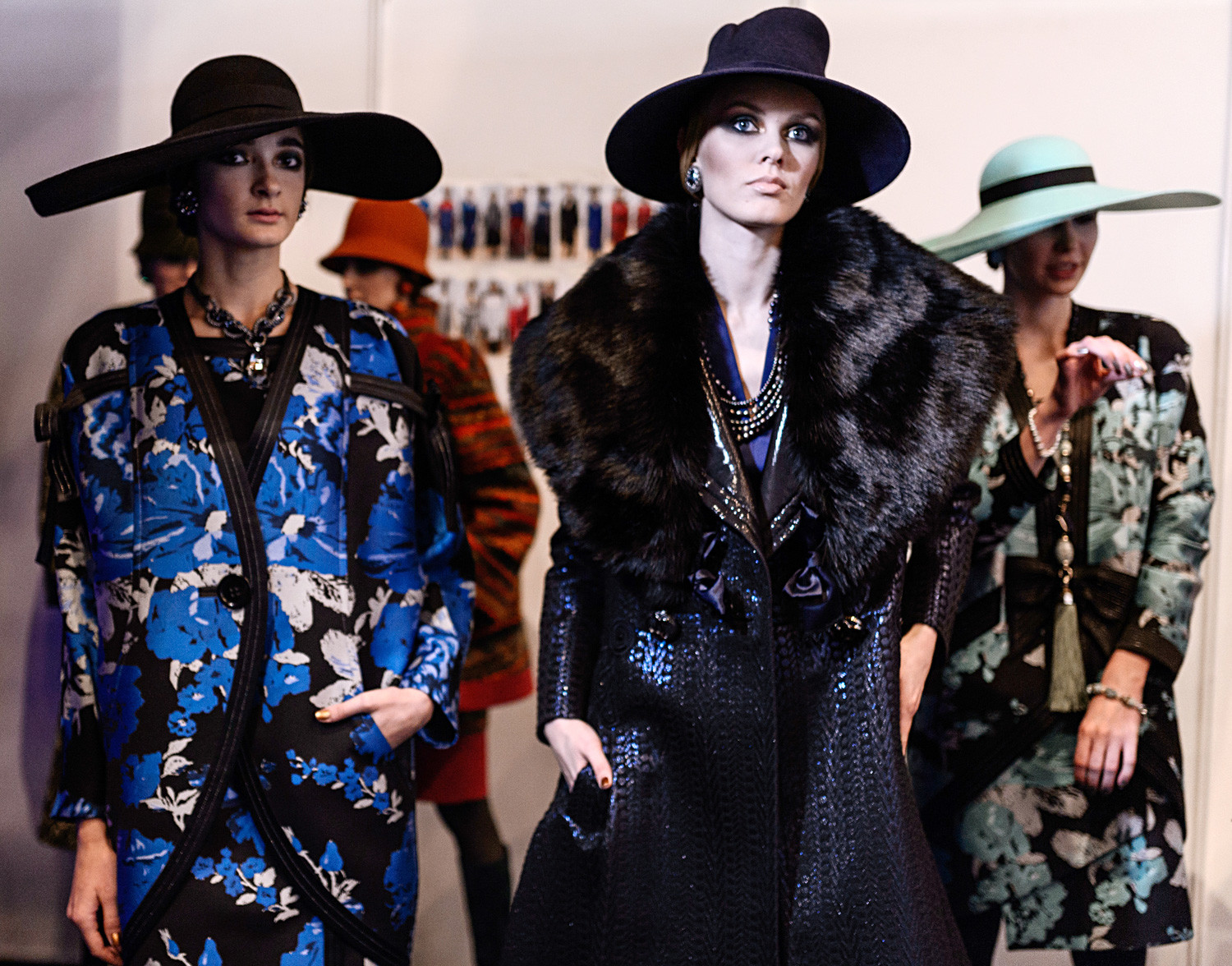 Models wear clothing by Slava Zaitsev at Mercedes-Benz Fashion Week in Moscow