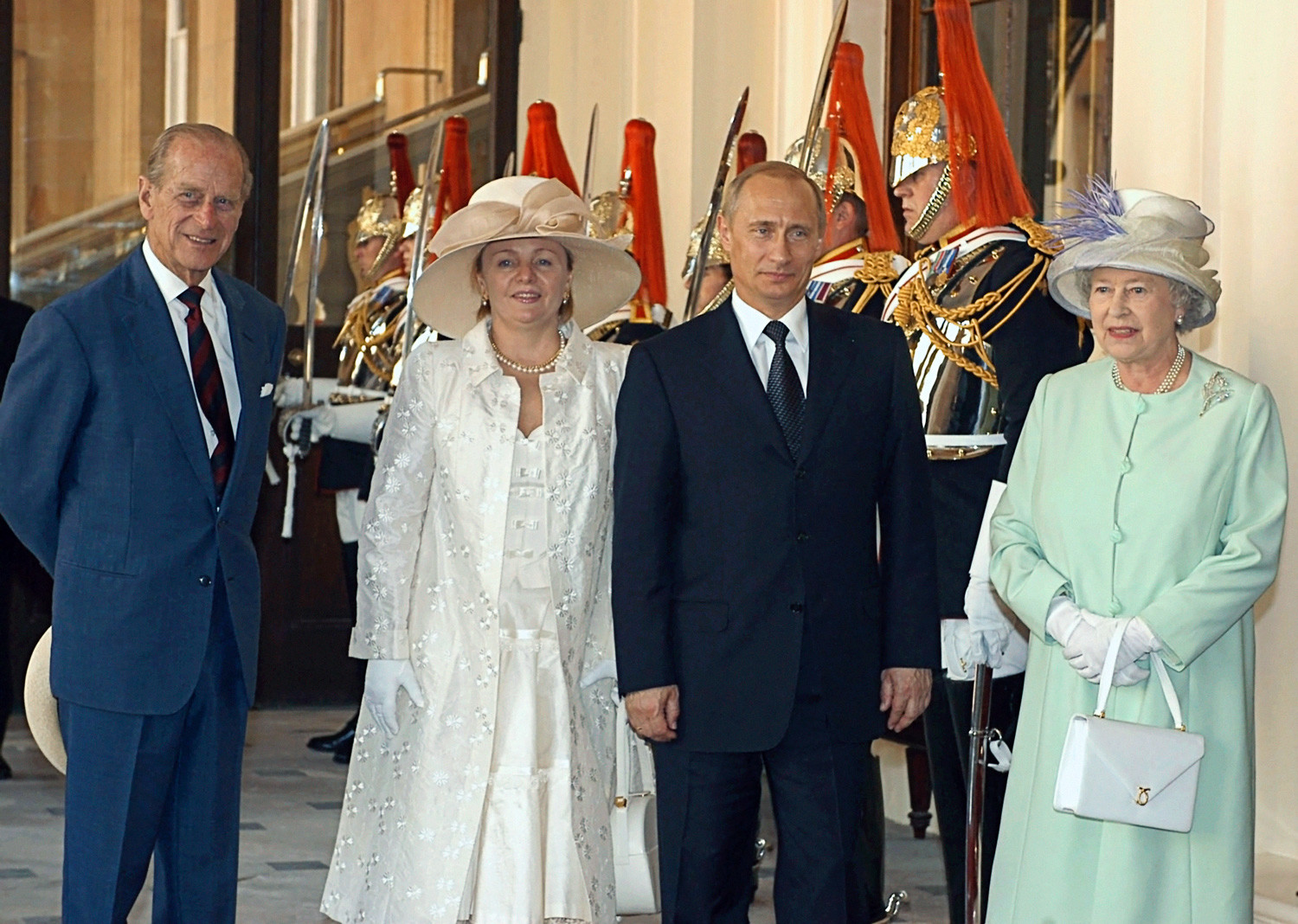 Vladimir Putin and Lyudmila Putina with Queen of Great Britain Elizabeth II and Duke of Edinburgh Philip in London.