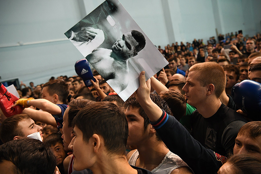 Fans ask for autographs during a master class by Mike Tyson in the city of Yekaterinburg