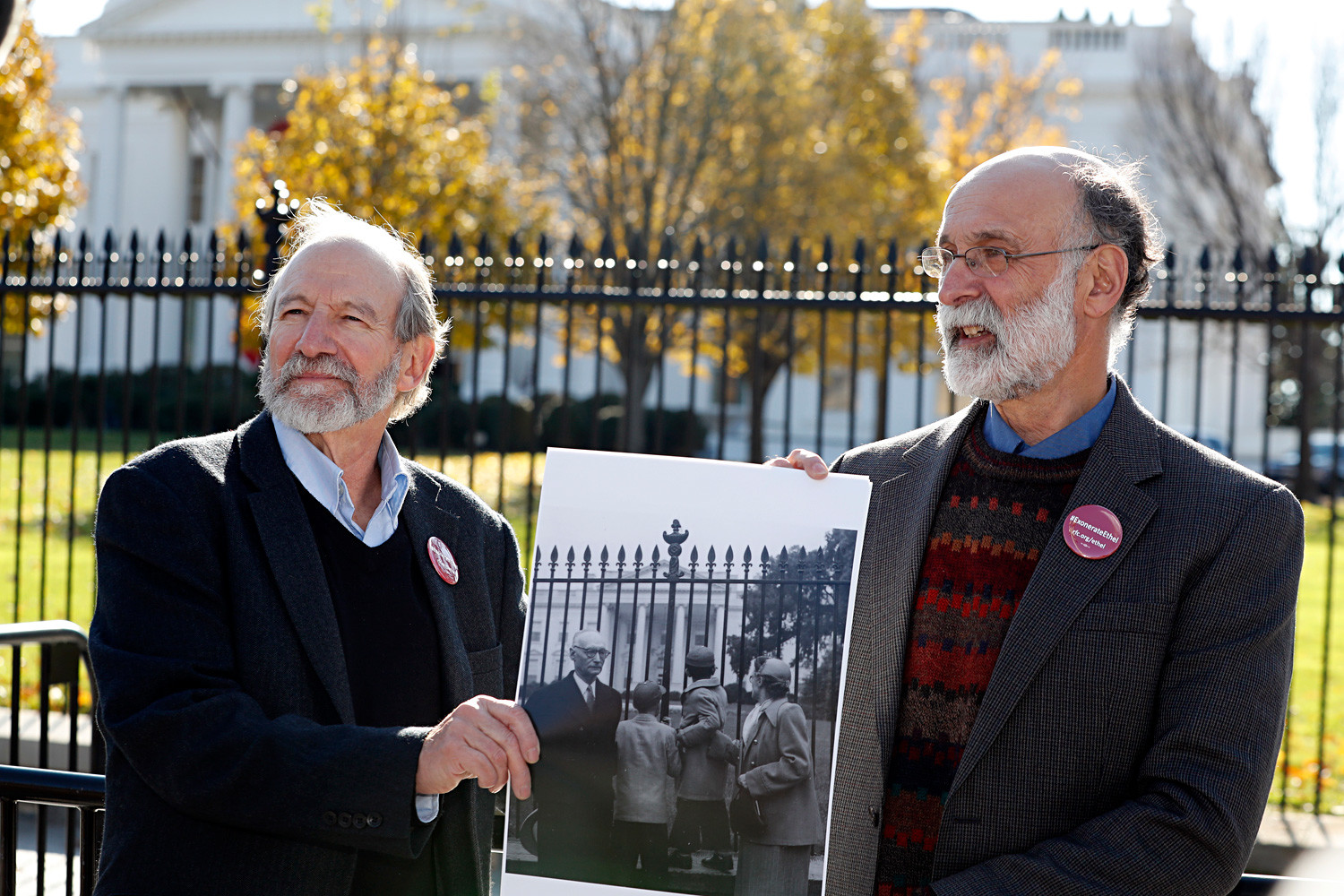 Michael, left, and Robert Meeropol, the sons of Ethel Rosenberg, pose similar to an old photograph of them, before they attempt to deliver a letter to President Barack Obama in an effort to obtain a exoneration for their mother Ethel Rosenberg, 2016.