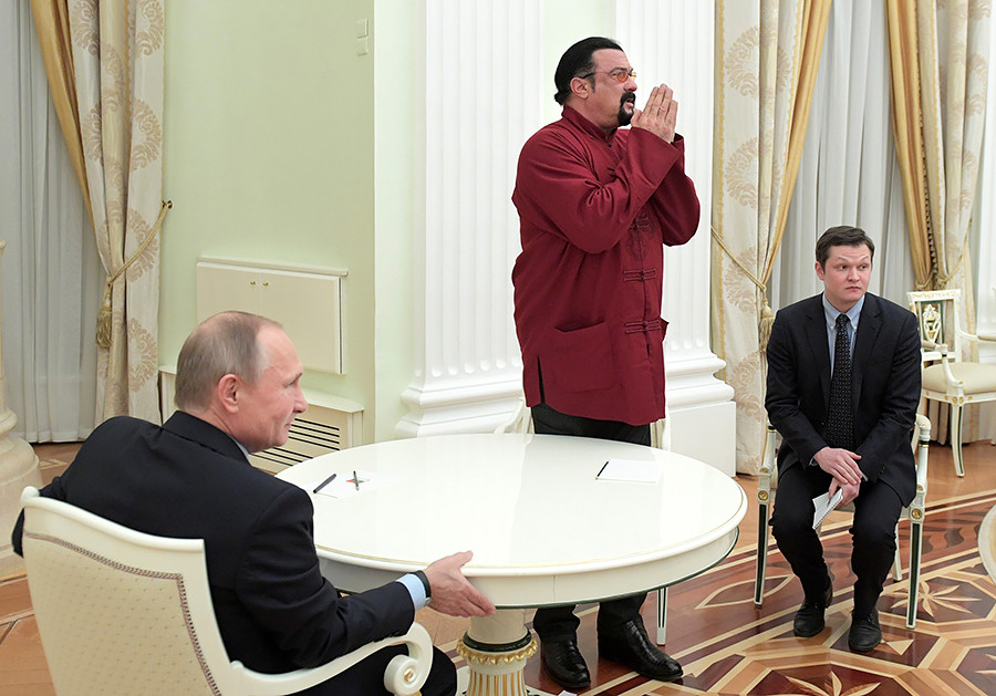 Vladimir Putin meets with Steven Seagal at the Kremlin in Moscow, 2016.