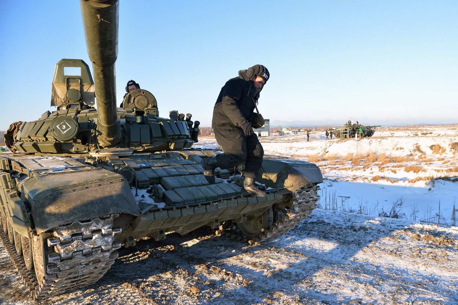 The T-80 tank at the Chebarkul shooting range outside Chelyabinsk during a demonstration session of the newly formed 90th Vitebsk-Novgorod two-times Red Banner guards tank division.
