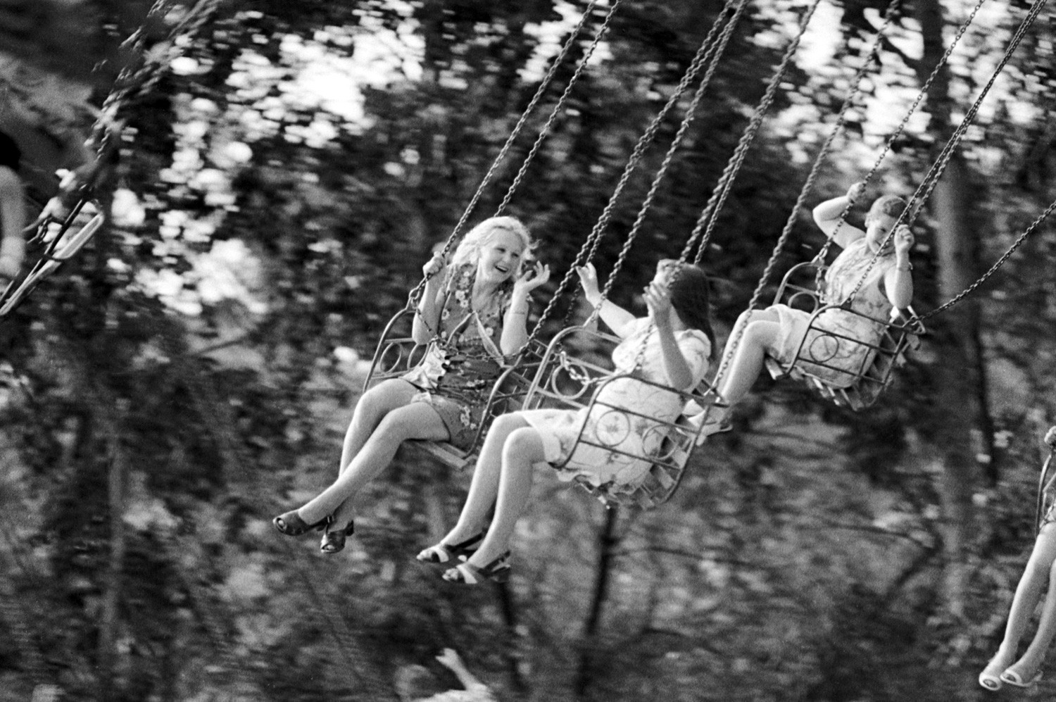 Children are swinging in Khabarovsk park.