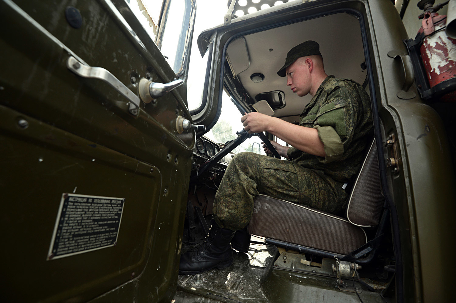 The driver of a truck at a military equipment storage, maintenance and repair facility in Novosibirsk. This facility will host a camp assembly of army reservists
