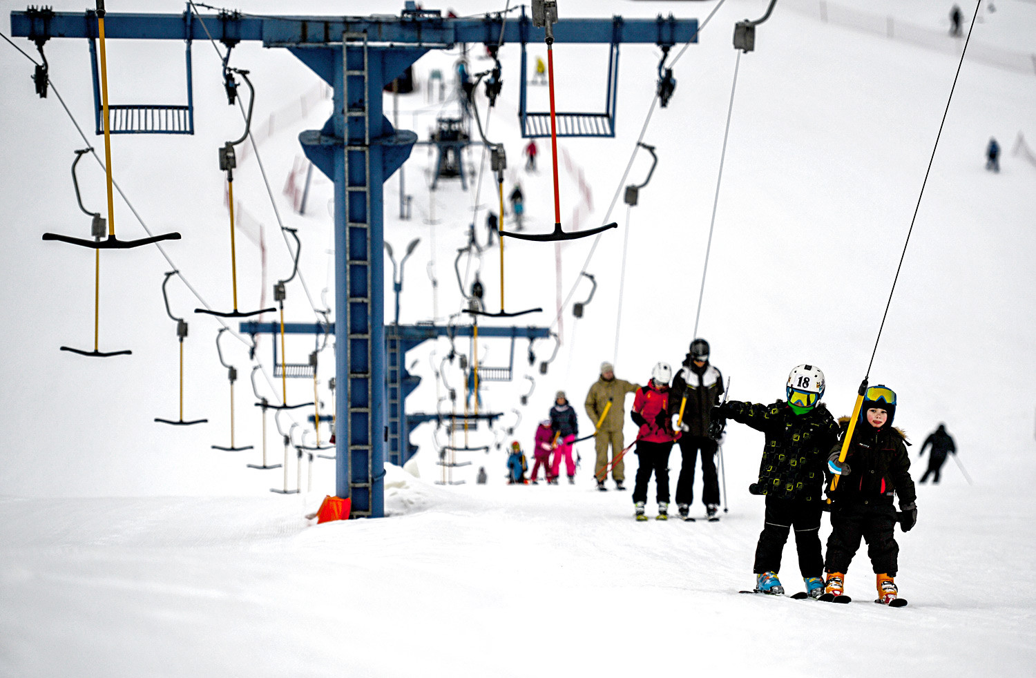 Children use a ski lift in Volen Sports Park (Yahroma) near Moscow.