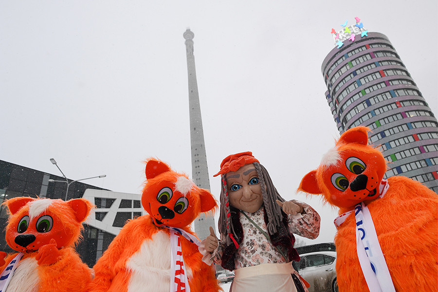 People wearing costumes take part in a rally titled 'Let's Hug Our Tower' against the demolition of an abandoned TV tower.