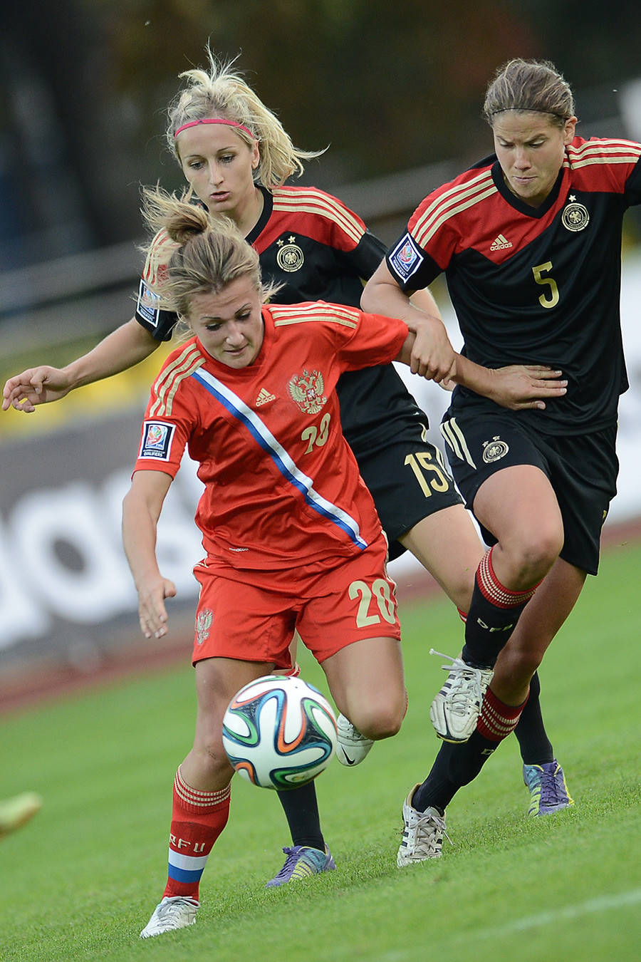 Nelli Korovkina (Russia), Kathrin Hendrich (Germany) and Annike Krahn (Germany), from left, during the Football World Cup 2015 qualification match between the national women's teams of Russia and Germany.