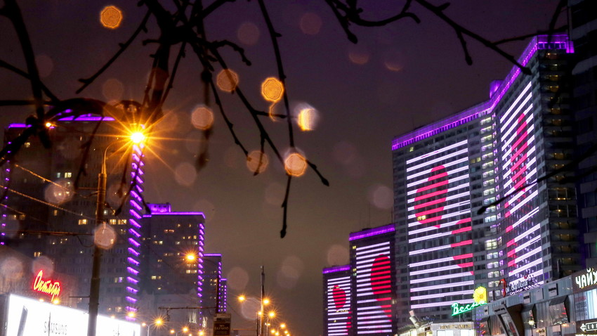 Red hearts projected on building in Novy Arbat Street on Valentine's Day