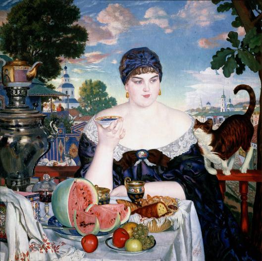 Žena trgovca pije čaj