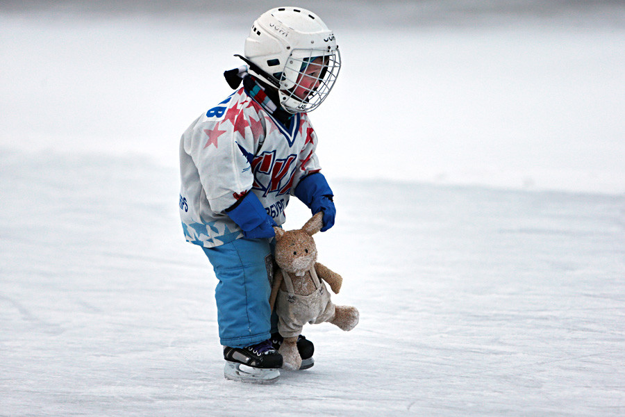 A young boy skating on an outdoor rink in St. Petersburg.