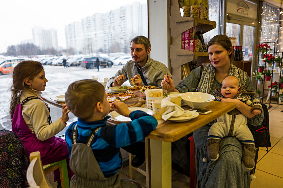 A Moscow's family eats in the cafe.