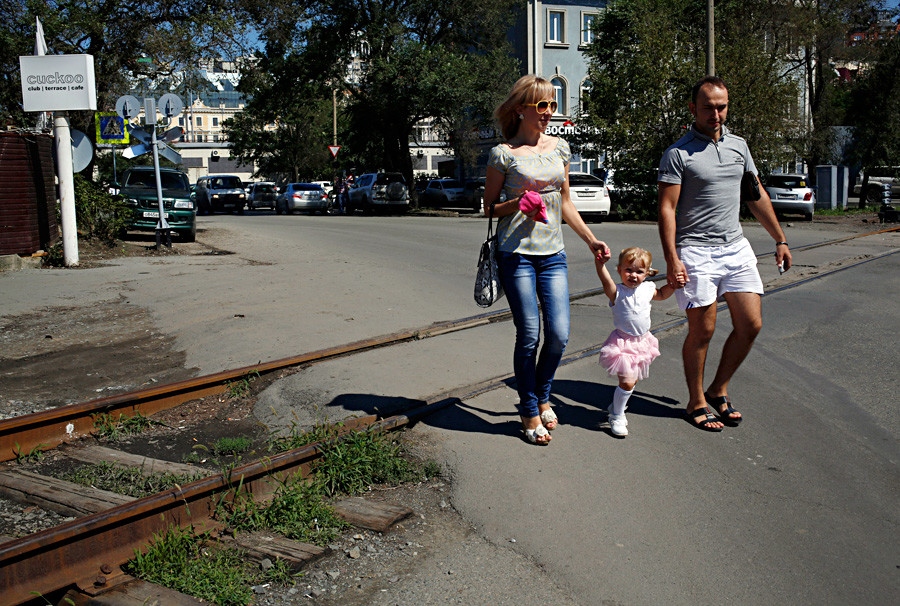 A family walk near the train station in the eastern Russian city of Vladivostok.
