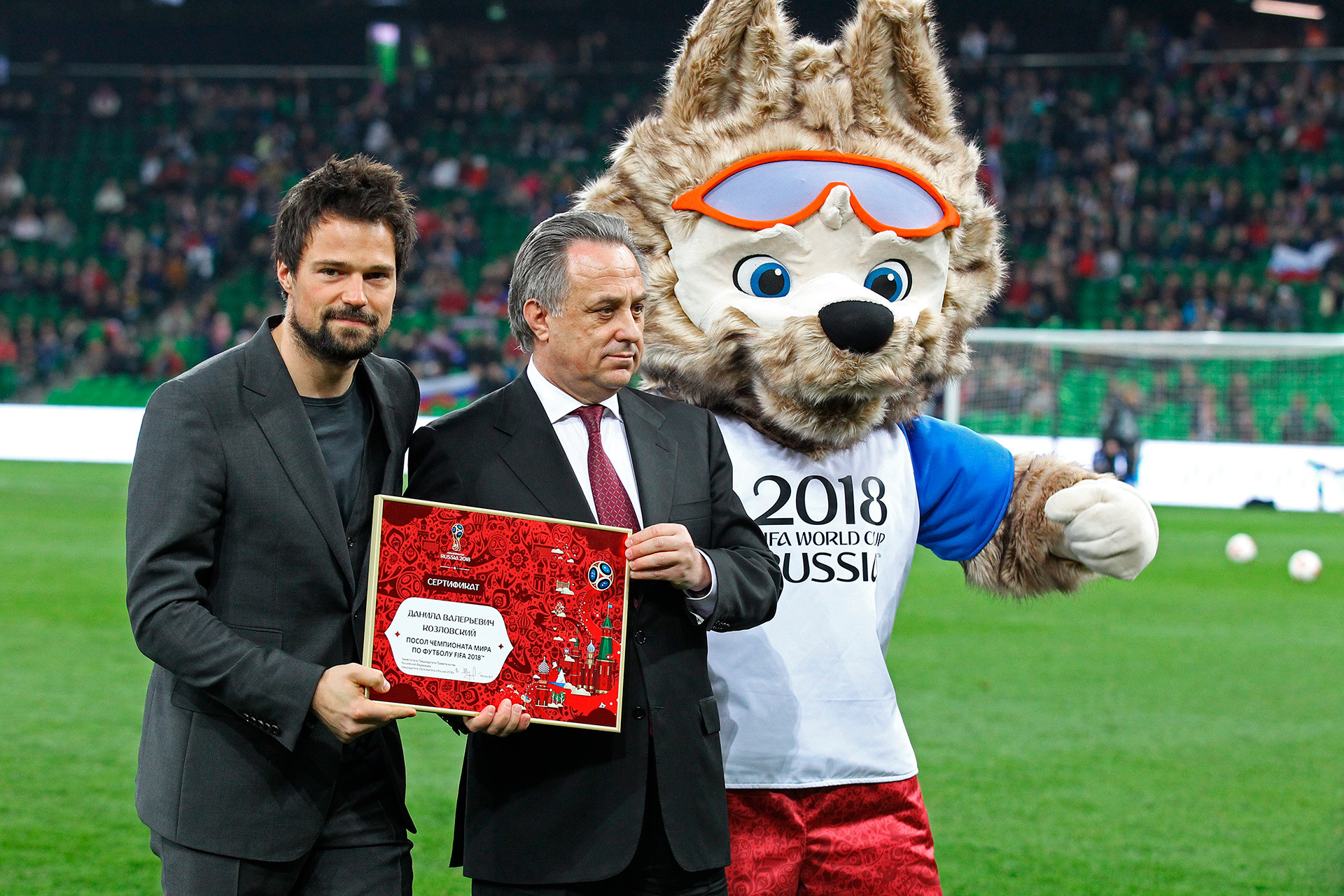 Danila Kozlovsky, President of the Russian Football Union Deputy Prime Minister V. Mutko and the 2018 FIFA World Cup official mascot Zabivaka during the ceremony of certifying Danila Kozlovsky as a 2018 FIFA World Cup Ambassador prior to the football friendly match between Russia and Côte d'Ivoire.