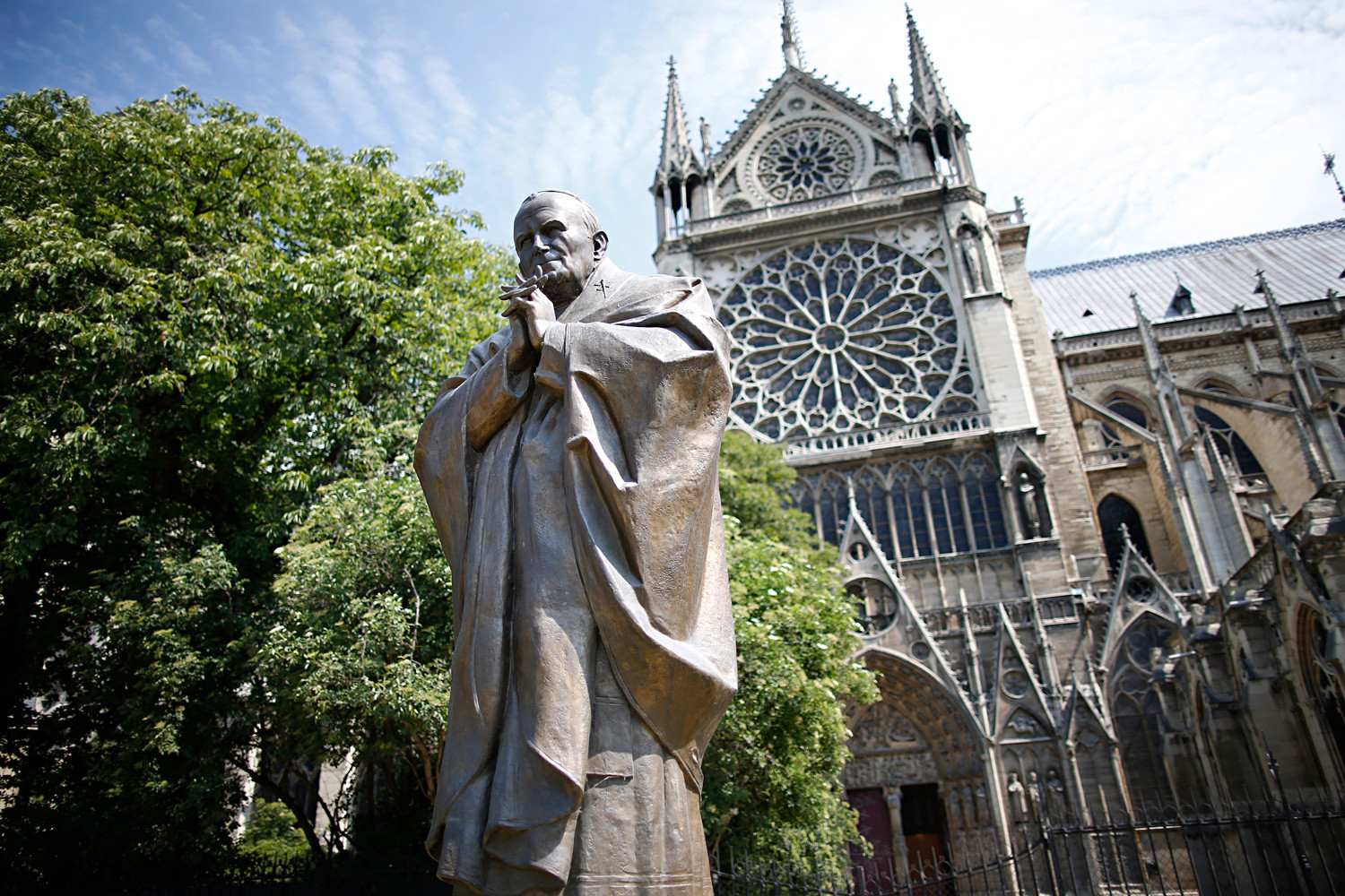 The sculpture of Pope John Paul II near the Notre-Dame Cathedral in Paris