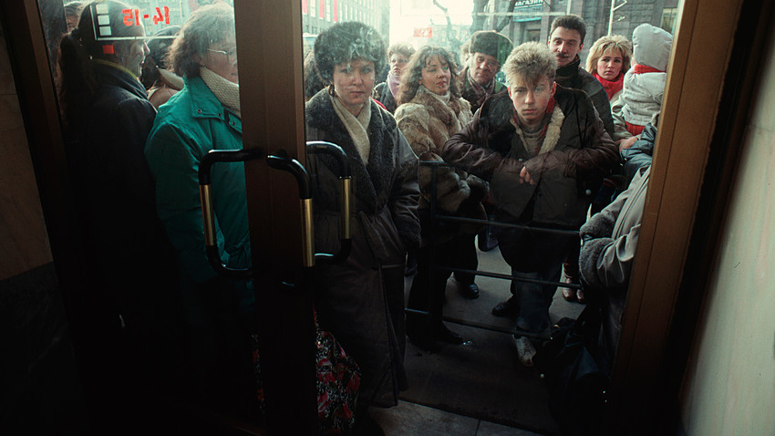 Russian citizens in Leningrad wait in line for the opening of a store during the Soviet economic crisis, January 01, 1987