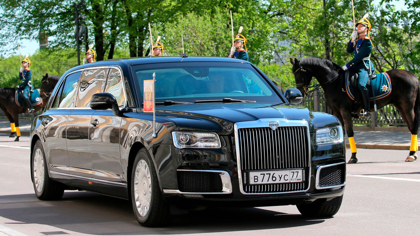 "Vladimir Putin demonstrates the new ""Kortezh"" car during his inauguration."
