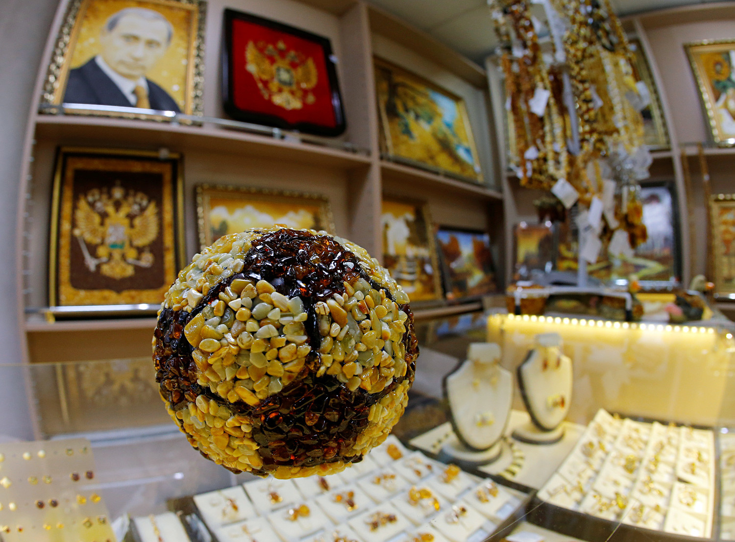 A soccer ball (yes, there's a portrait of Vladimir Putin on the wall, also made with amber)