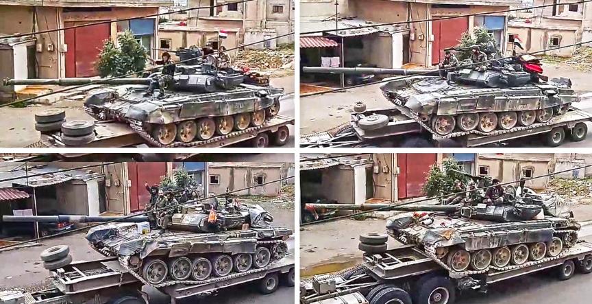 Tigri skupaj s tanki na poti v Rastan.