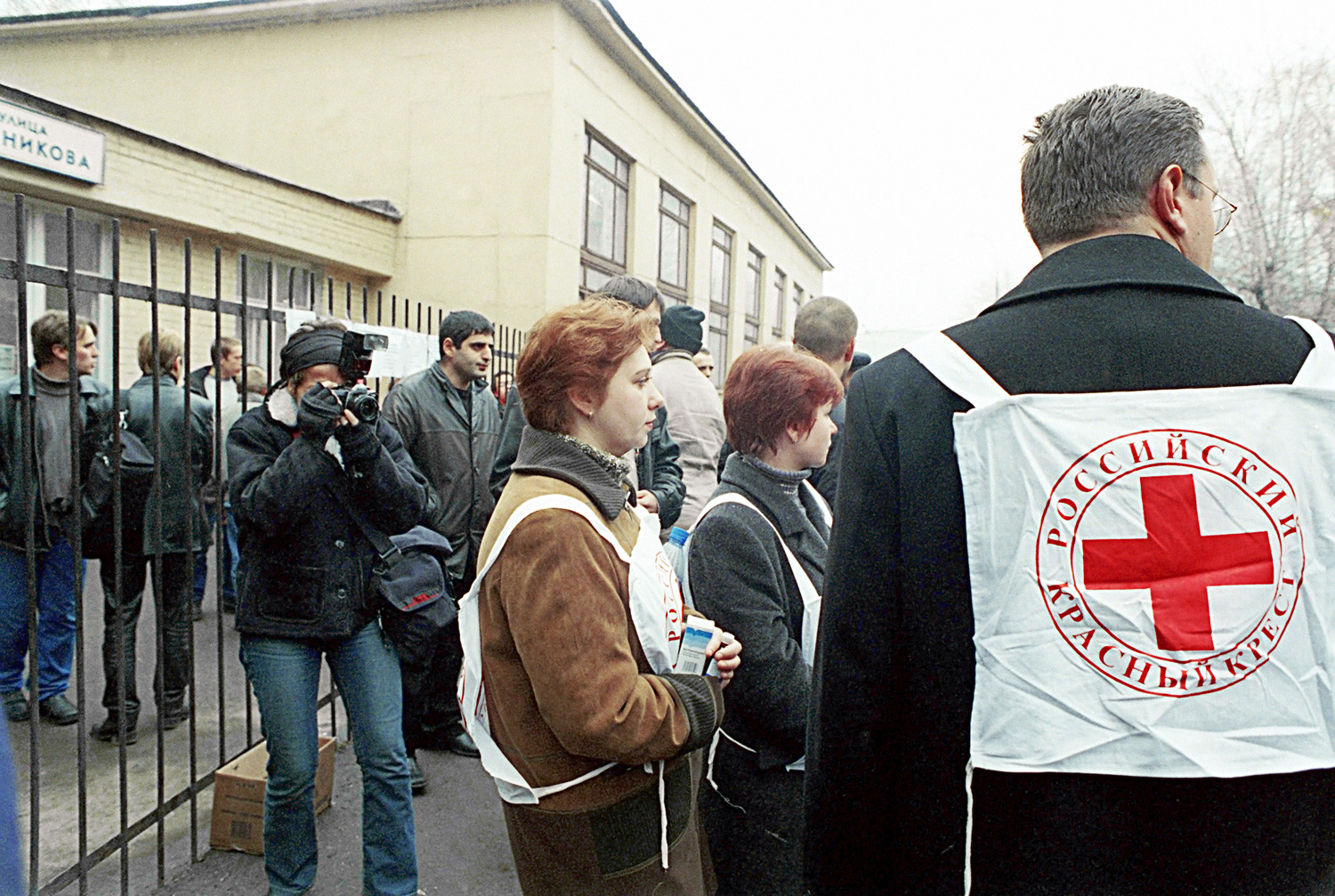 Red Cross workers at the Moscow Theater in the Dubrovka area, where Chechen terrorists took hostages during Nord-Ost performance in 2002.