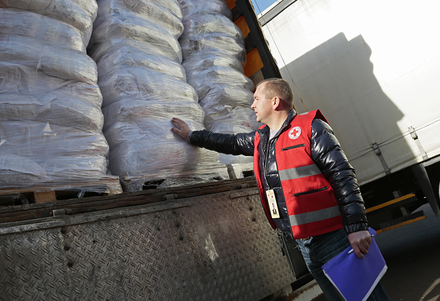 An employee of the Moscow city branch of the Russian Red Cross seen ahead of sending the 2nd humanitarian aid convoy to Donetsk.