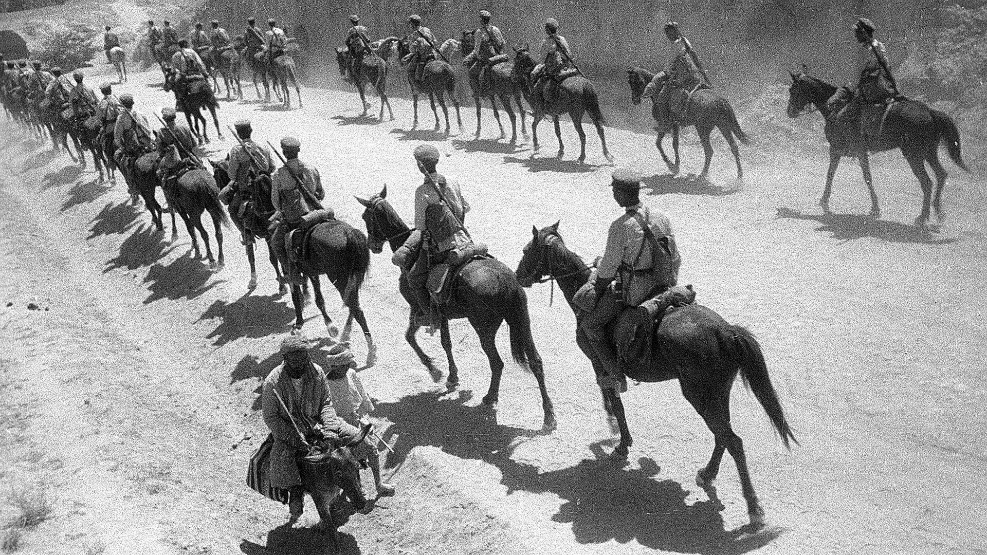 Red cavalrymen on the march.