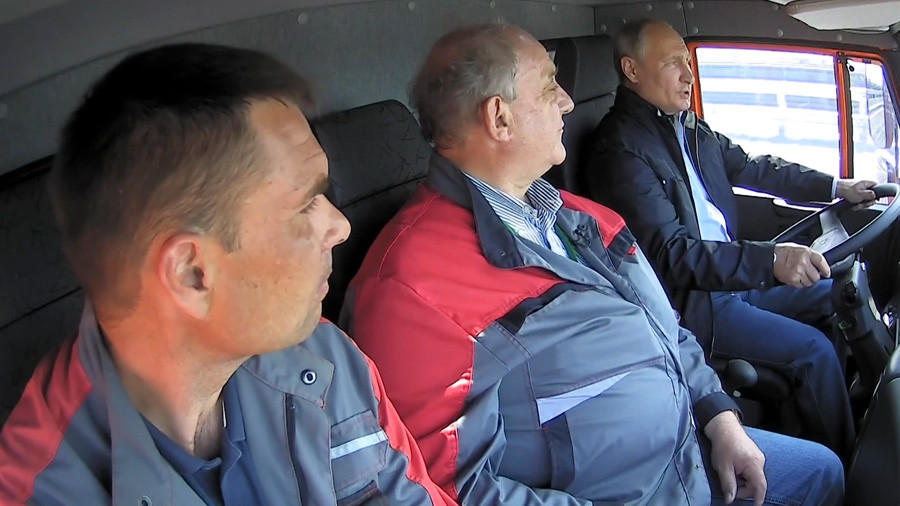 The Federal Protection Service said Putin was driving a truck before the road was officially opened