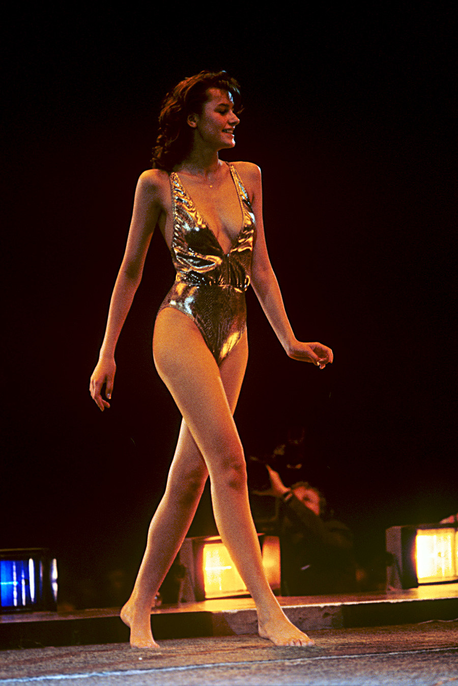Maria Kalinina (school girl, 17 years old) during the catwalk in swimwear.