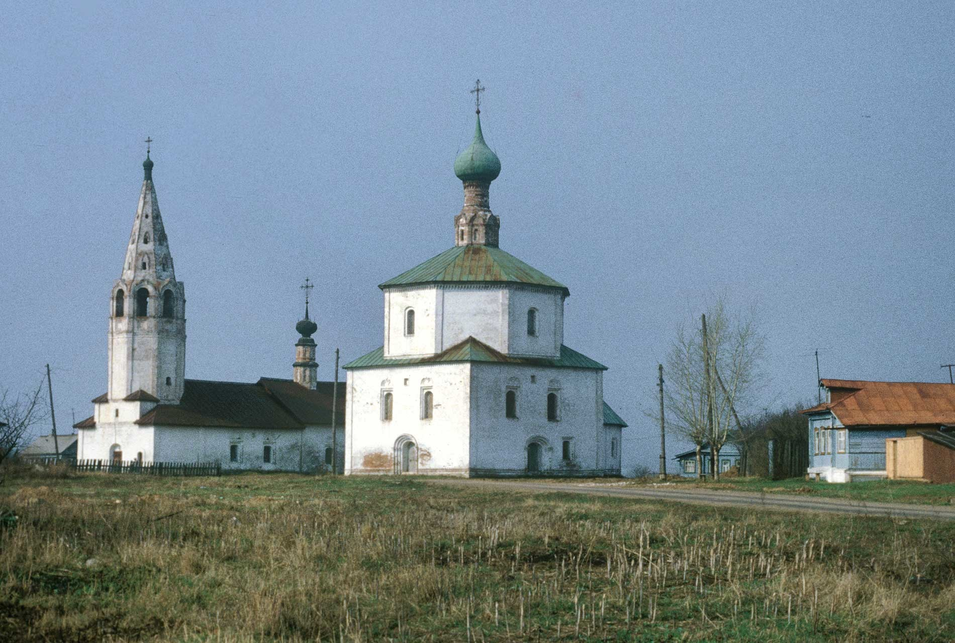 Suzdal. Church of Elevation of the Cross (left)&Church of Sts. Cosma & Damian in Korovniki. Southwest view. April 27, 1980.