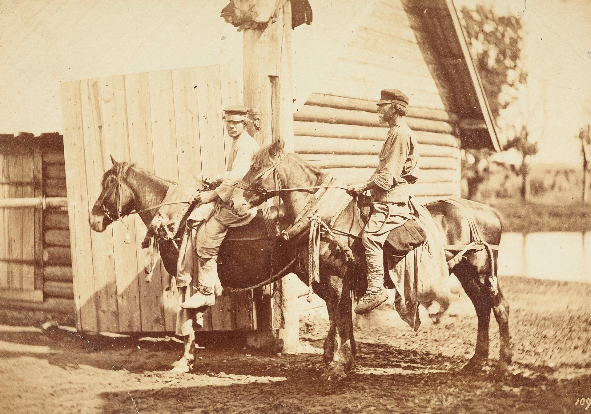 馬に乗っている農民たち