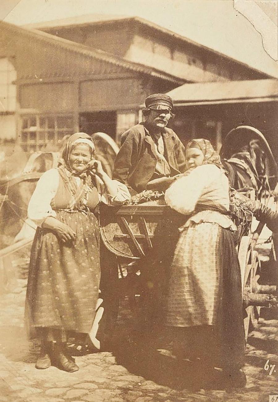 荷馬車のそばの農民たち