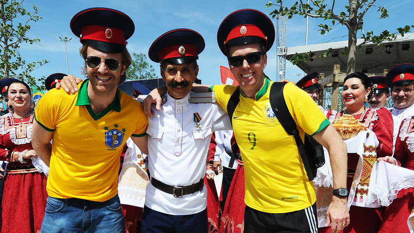Brazil's fans pose for a photo with a Cossack upon arrival in Rostov-on-Don, Russia