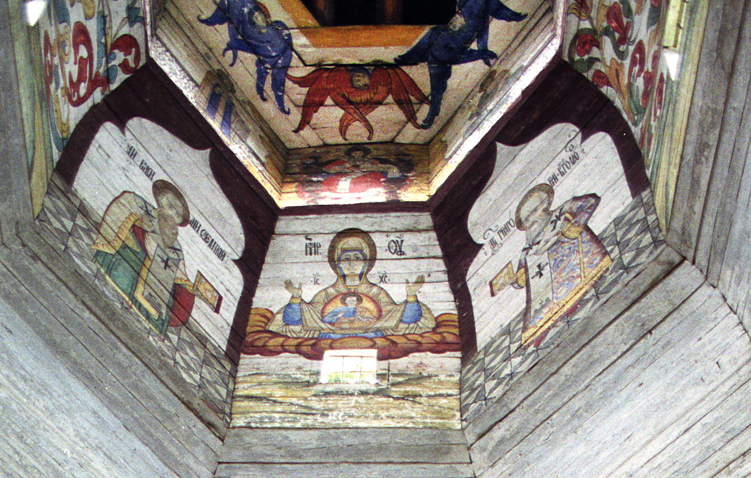 Church of the Tikhvin Icon of the Virgin (Old Church of the Ascension). View of paintings on east wall of upper tier. From left: St. Basil the Great, Virgin Mary of the Sign, St. Gregory the Theologian. Aug. 19, 2006.