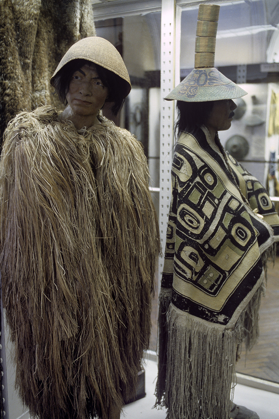 Native Americans wearing cloaks made of hay (left) and vegetable fibers. The 19th century. Showpiece of the Peter the Great Museum of Anthropology and Ethnography (Kunstkamera) of Russia's Academy of Sciences.