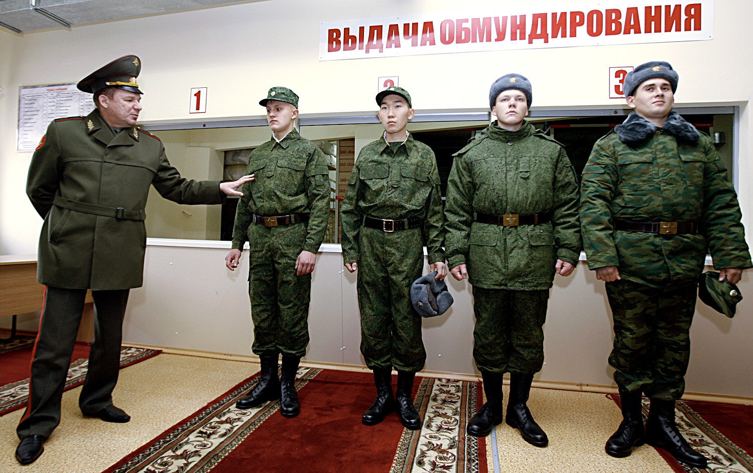 Recruits seen at the outfit room before leaving for the army service from a Kazan conscription office.