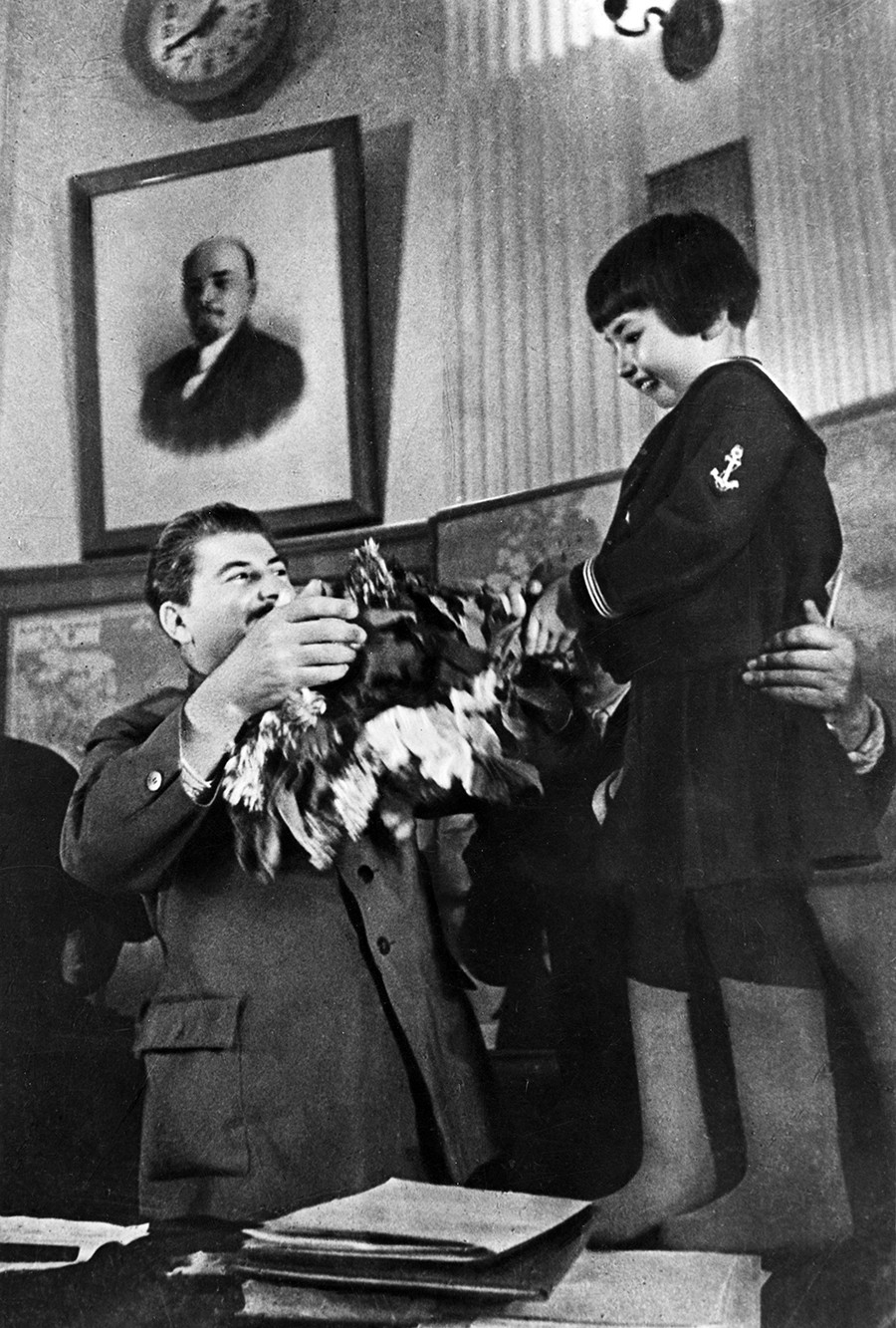 Joseph Stalin receiving a bouquet of flowers from Engelsina (Gelya) Markizova.