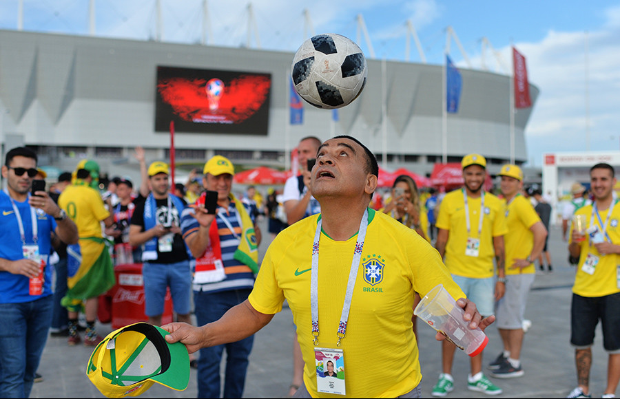 Brazil's fan plays with a ball ahead of the World Cup Group E soccer match between Brazil and Switzerland in Rostov-on-Don, Russia, June 17, 2018.