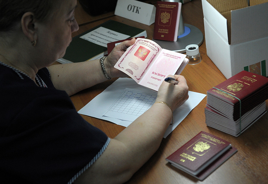 Employee of FSUE Goznak checks the quality of finished biometric passports for Russian citizens in the Reserve personalization Center at FSUE