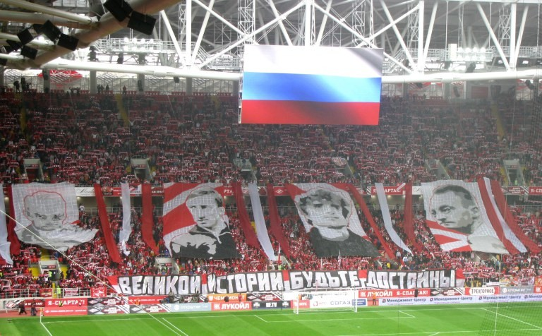 Spartak fans urge their current team to live up to the club's lustrous history prior to the opening league game at the Otkrytiye Arena.