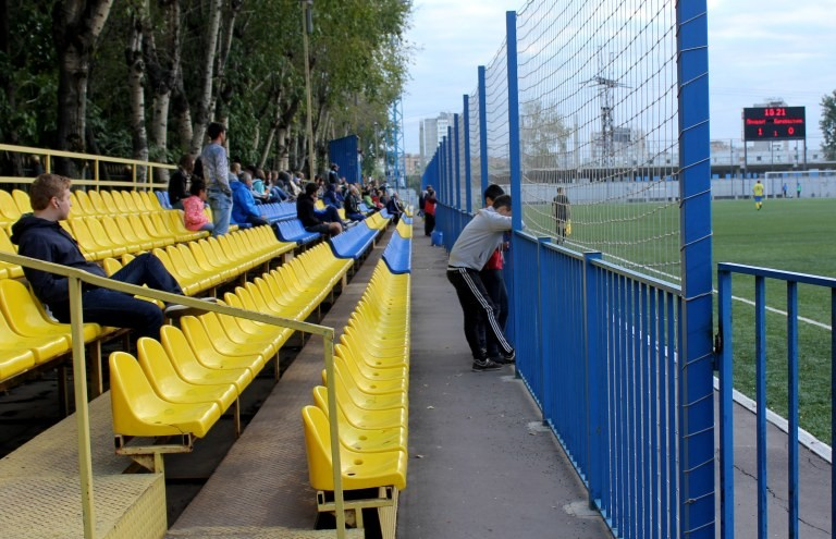 A small crowd gathers at the new seating area at Reutov's Start Stadium.