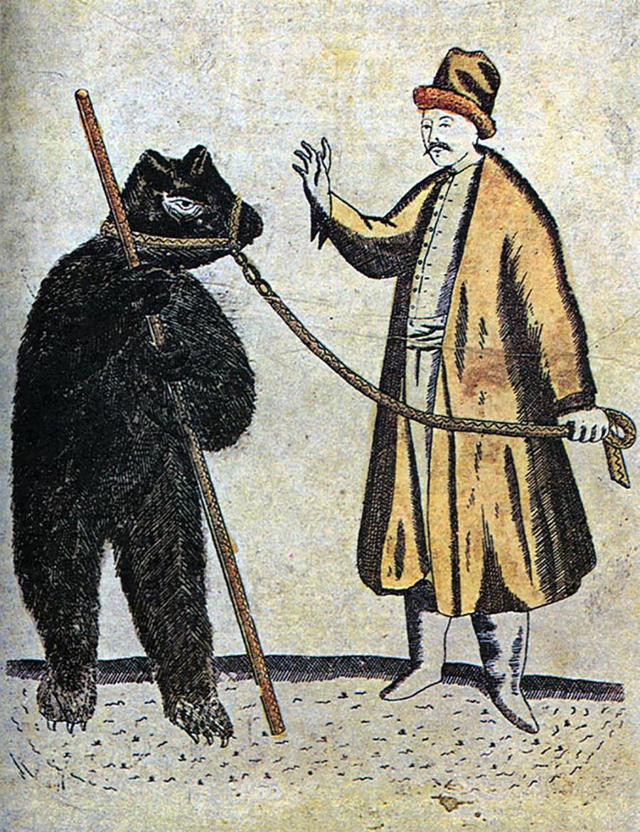 Um domador e seu urso no século 19. Domínio público