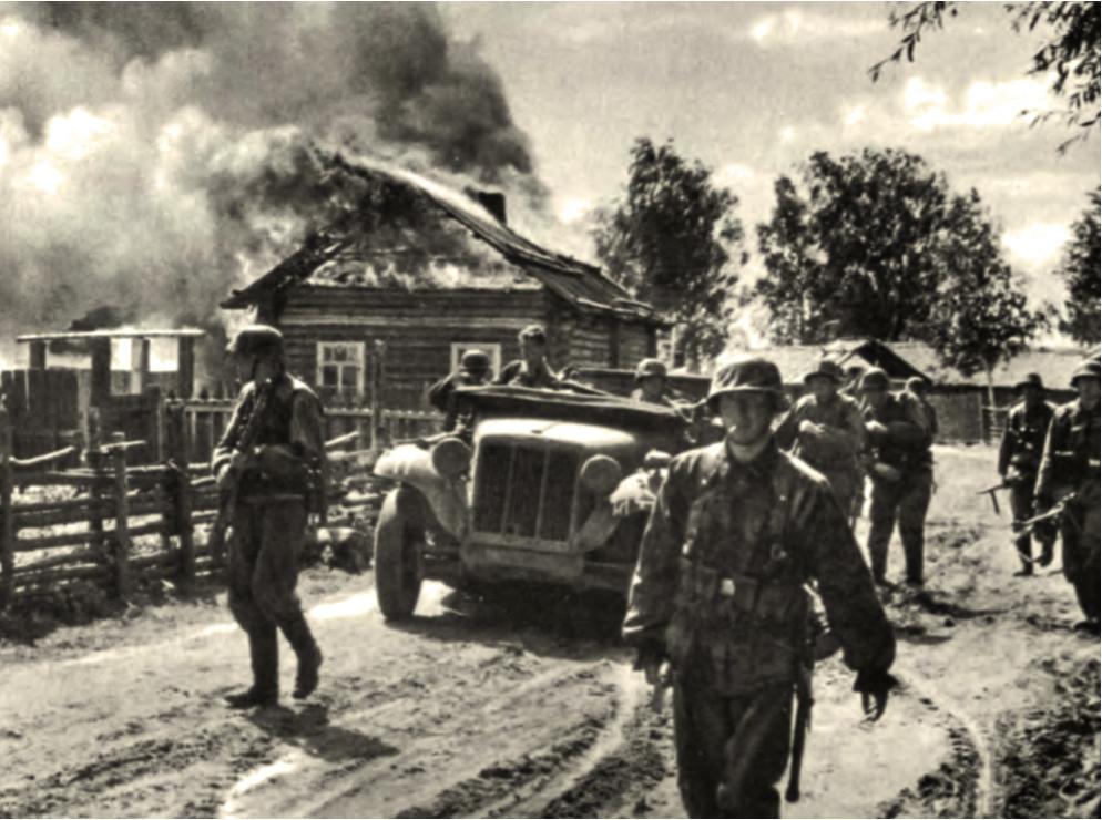 Enote nemške 2. SS-oklepne divizije Das Reich uničujejo zavzeto vas.