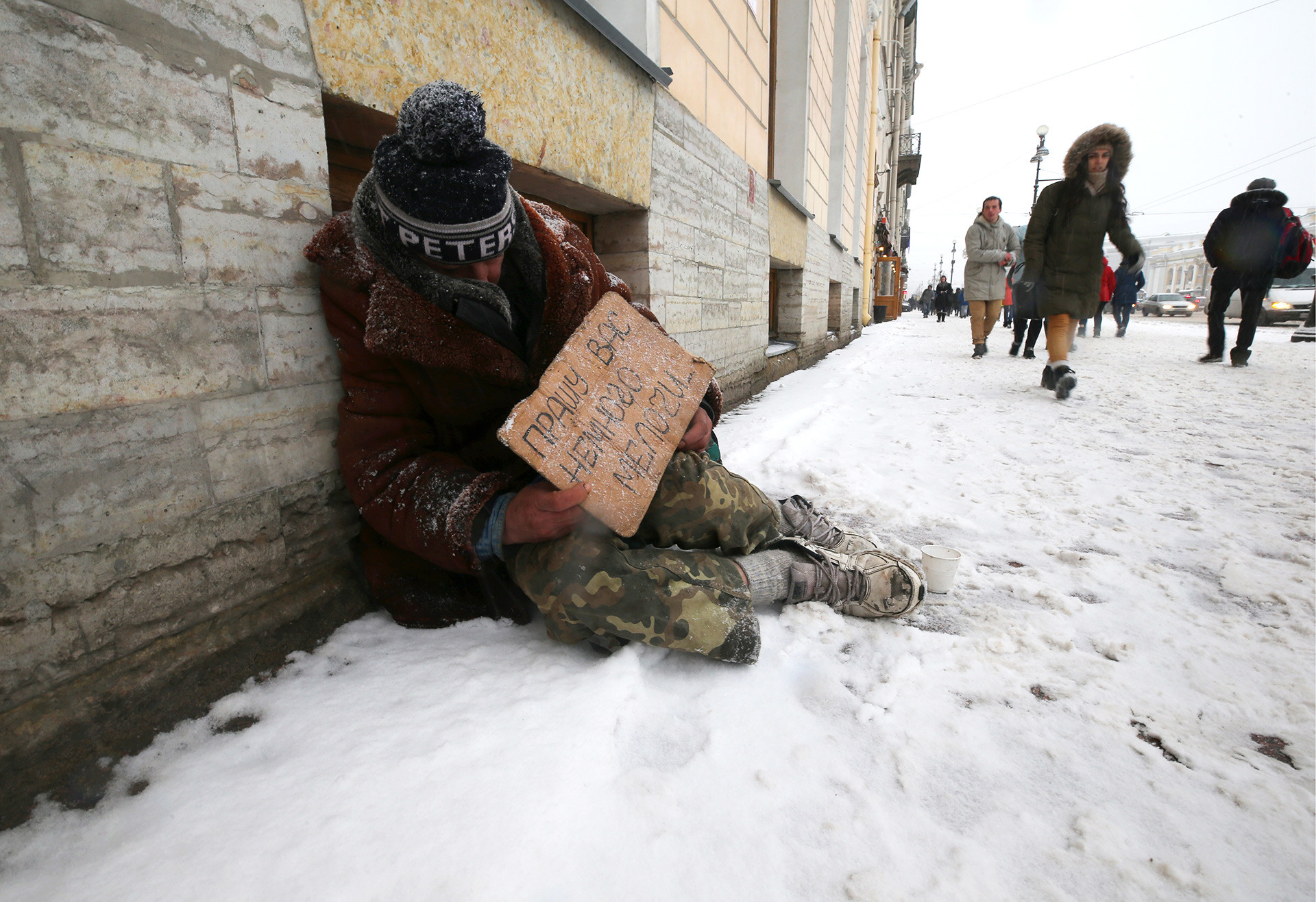 Homeless man sleeping rough, Russia