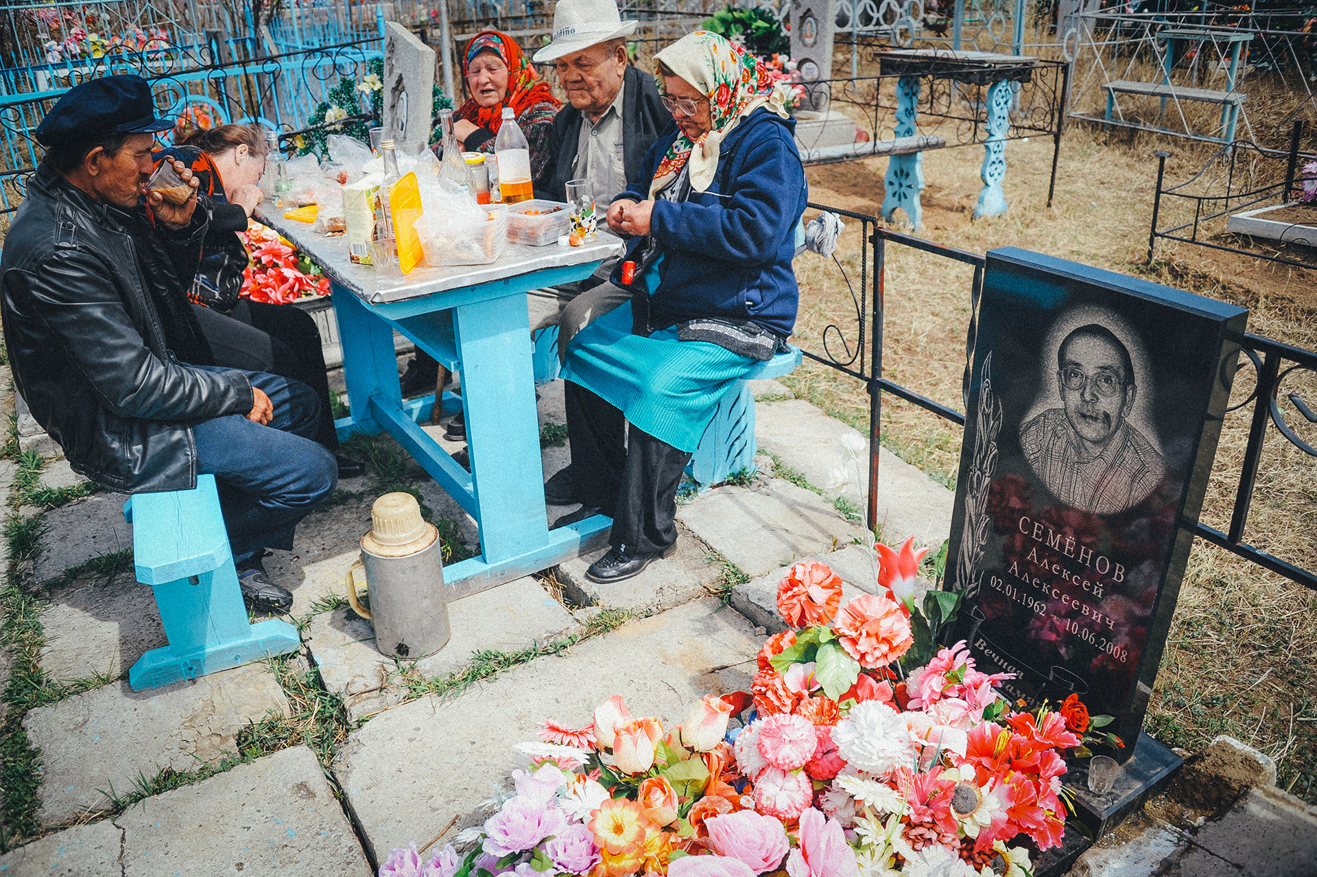 Russians having a commemorative meal at the grave of their relative