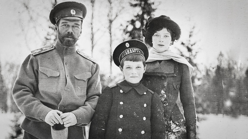 Tsarevich Alexei with his father and sister.
