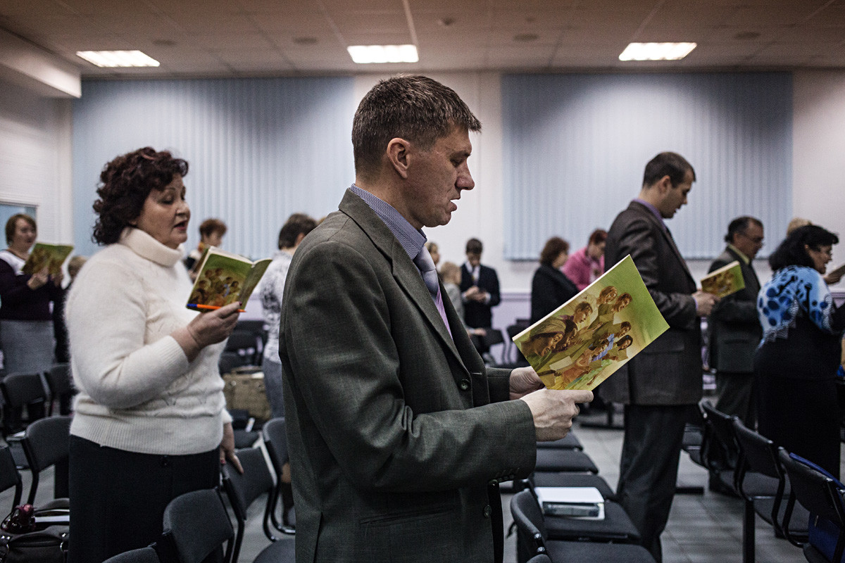 Jehovah's Witnesses sing songs at the beginning of the meeting in Rostov-on-Don on November 13, 2015.