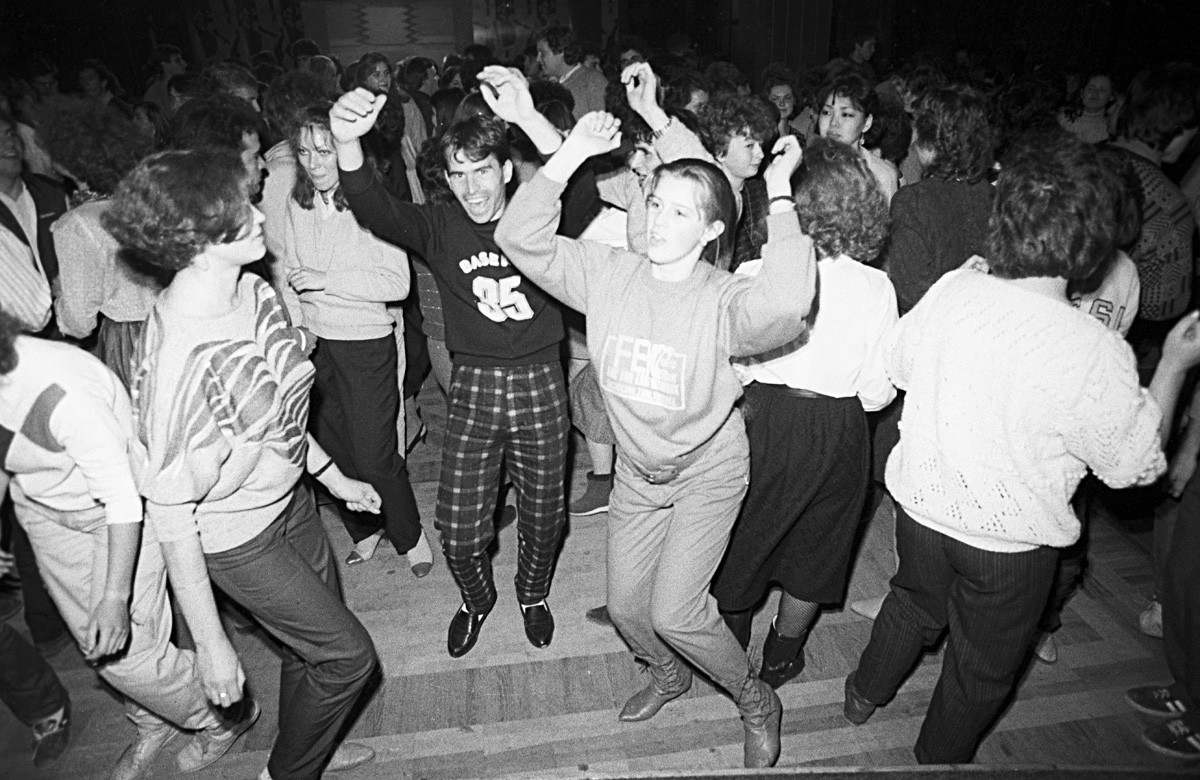 Young people dance  at a disco night at the Gorky Park Moscow