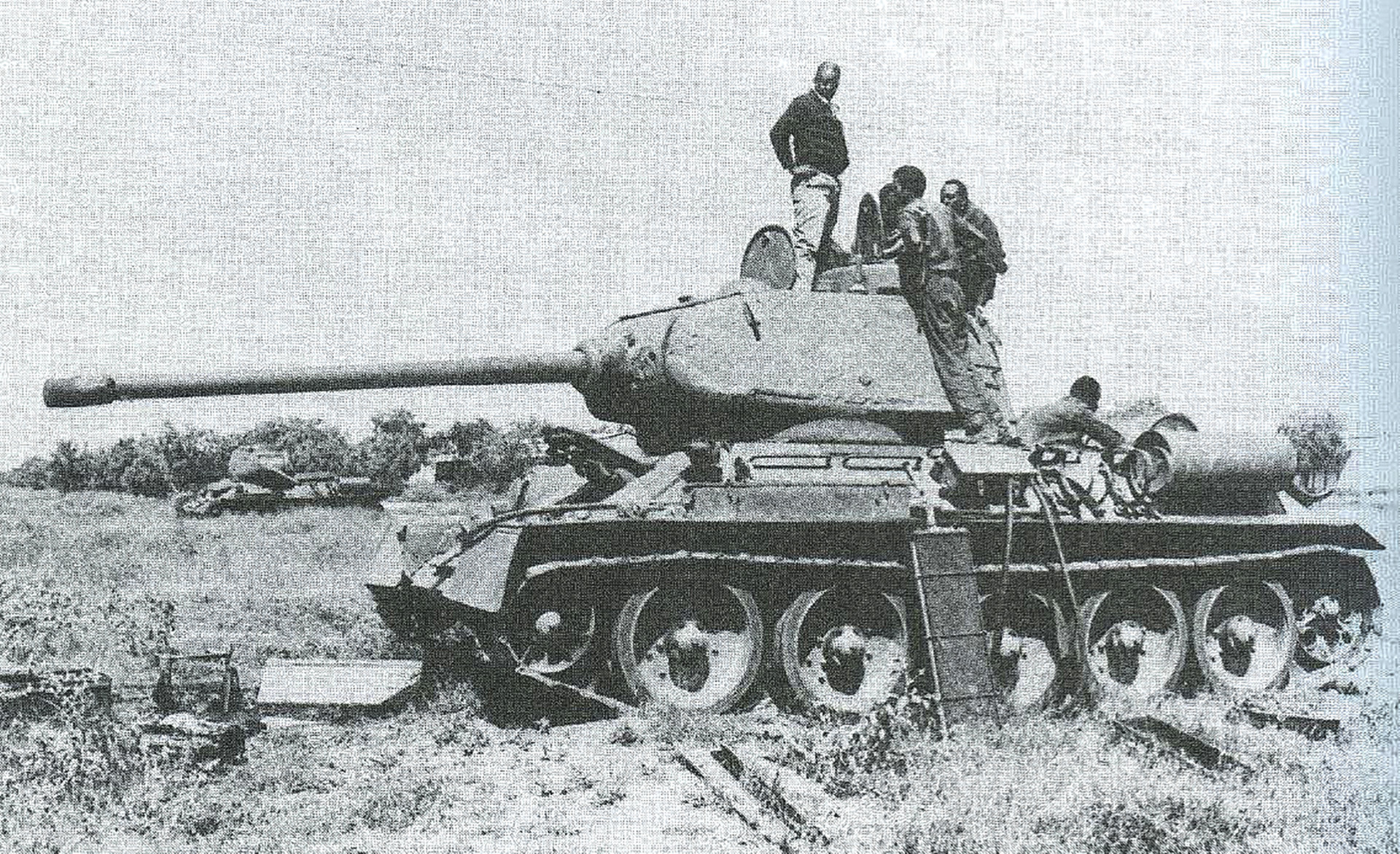 A heavily damaged Somali National Army T-34 going through repairs.